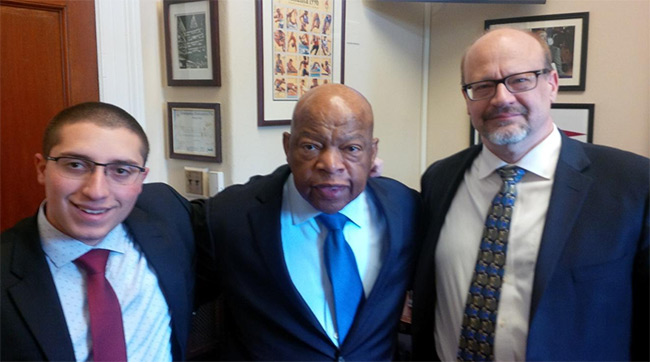 Paul Corda (left) and Dale Skran (right) following a meeting with Rep. John Lewis (D-GA).