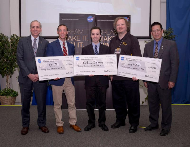 NASA's Associate Administrator of the Space Technology Mission Directorate, Steve Jurczyk, Benjamin Fried of team CU-E3, Kyle Doyle of team Cislunar Explorers, Wesley Faler of Team Miles, and NASA's Ames Research Center Director, Eugene Tu. Credits: NASA/Dominic Hart