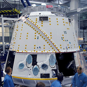 Technicians work on the Dragon spacecraft in SpaceX facility in Hawthorne, CA
