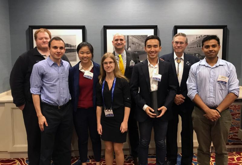 Adam Zachar, Laura Gao and Jaimie Carlson from Team Proto Fluidics, Hyung Jin Yoo from Team H2, and Hasan Latif from Team Bengal Tigers standing with Mike Snyder of Made In Space, John Quinn from EXOS Aerospace and Edward Kiker from Kepler Space Institute.