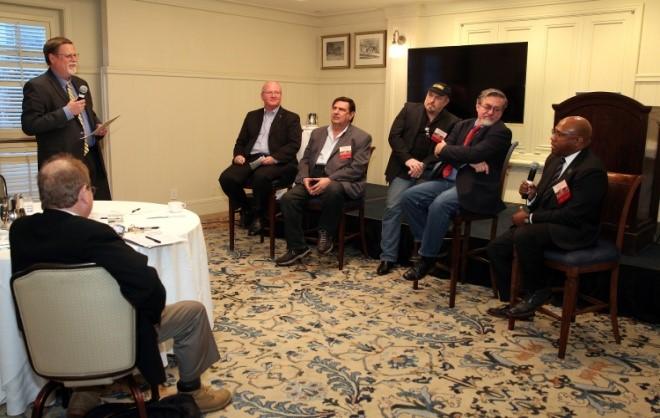 Left to Right, Mark Hopkins addresses the SSS wrap-up panel of Jeff Greason, James Bennett, Rick Tumlinson of DSI, John Mankins, and Karlton Johnson.