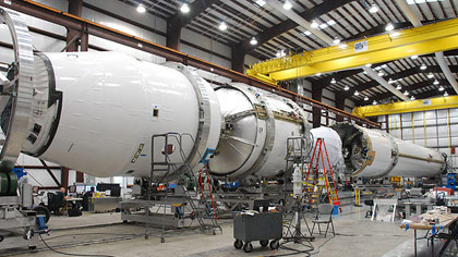 Falcon 9 flight hardware undergoing final integration earlier this month in the hangar at SpaceXs Cape Canaveral launch site in Florida. Credit: SpaceX.