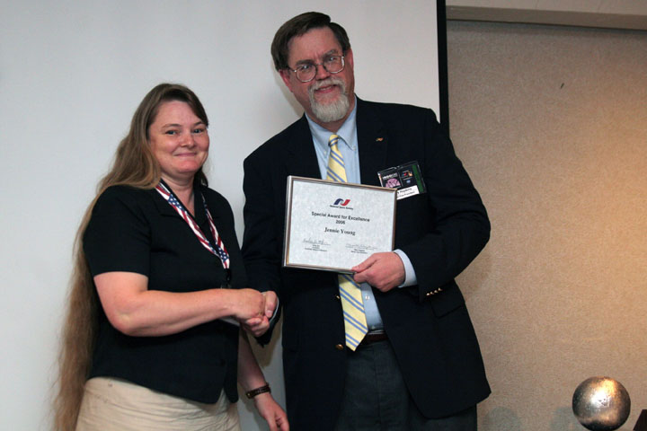 Jennie Young accepts an NSS Award for Excellence from Mark Hopkins at 2006 International Space Development Conference