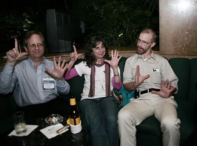 Alan Boyle, Robin Snelson, and Lee Valentine make  L5 hand signs late night at the International Space Development Conference