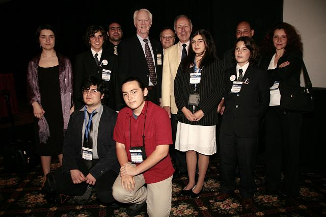 Apollo astronaut Schweickart and Ben Bova, author and member of the NSS Board of Governors, pose with a student group at the International Space Development Conference