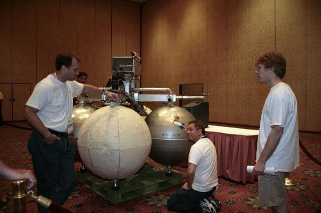 Armadillo Aerospace CEO John Carmack (R) confers with Armadillo Aerospace team members at the International Space Development Conference
