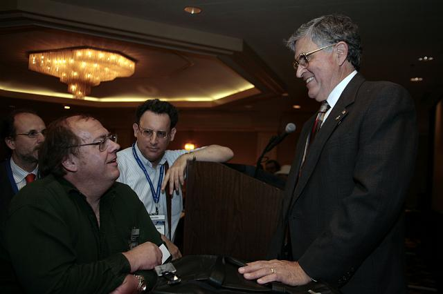 Astronomer Alan Hale (L) talks with former Astronaut and Senator, Harrison 'Jack' Schmitt (R) following his presentation at the International Space Development Conference