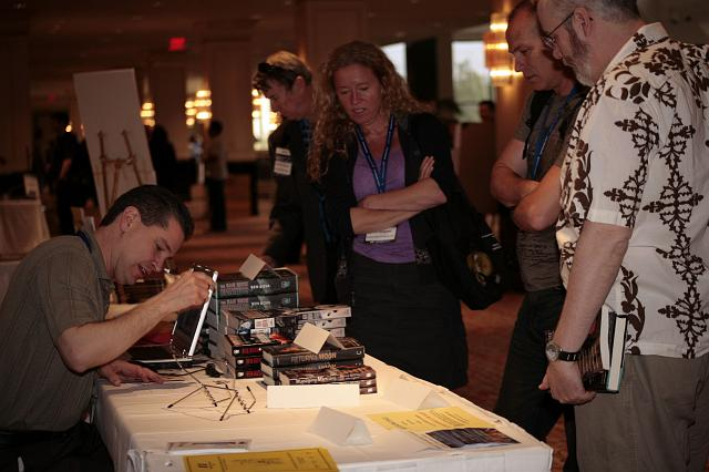 Author Brian Enke signs copies of his book Shadows of Medusa at the International Space Development Conference