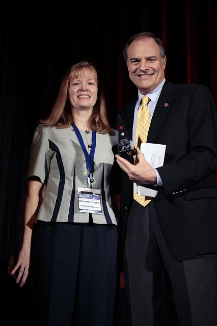 Author and NSS Director Marianne Dyson presents Rep. Nick Lampson with an NSS Pyramid as thanks for participating in the International Space Development Conference hosted by the National Space Society, on May 25, 2007, in Dallas, TX.
