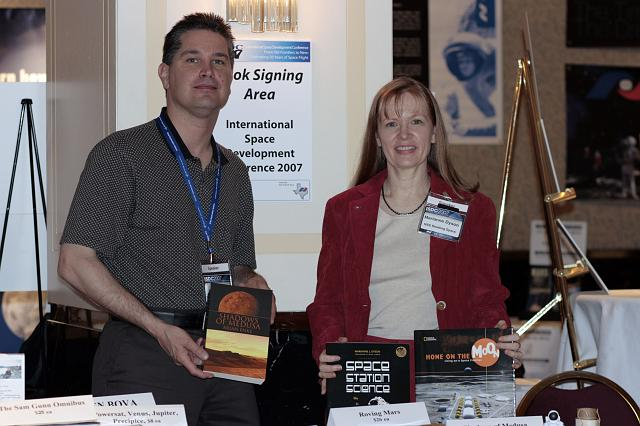 Authors Brian Enke and Marianne Dyson pose with their books at the International Space Development Conference