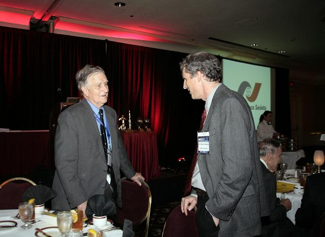 NSS Governor Frederick I. Ordway III talks with Mars Exploration Rover scientist Steven Squyres at the International Space Development Conference