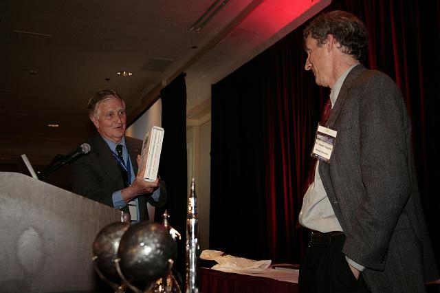 NSS Governor Frederick I. Ordway III presenting Steven Squyres with a biography of Wernher von Braun at the International Space Development Conference