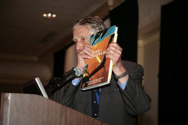 NSS Governor Frederick I. Ordway III  displaying a copy of his outstanding book Visions of Spaceflight: Images from the Ordway Collection at the International Space Development Conference