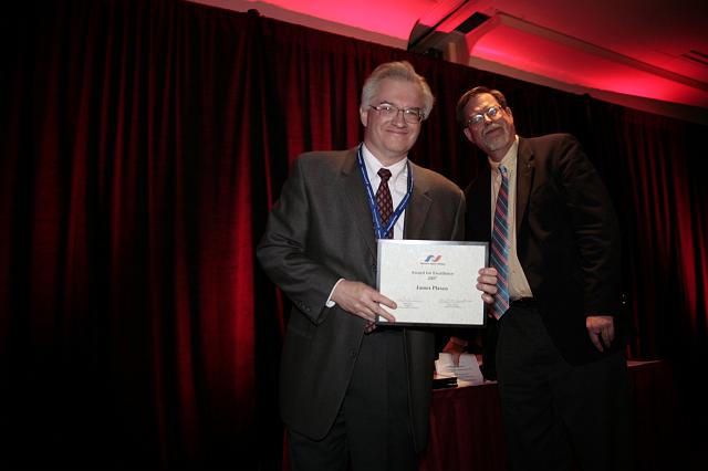 James Plaxco accepts the NSS Award for Excellence from NSS Senior Vice President Mark Hopkins at the International Space Development Conference