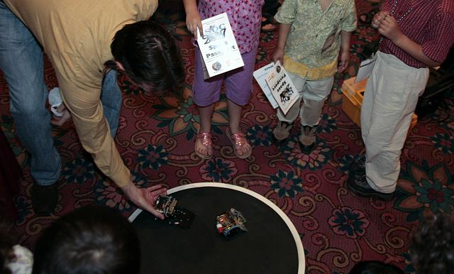 Kids play with robots at the Robotics Group exhibit at the International Space Development Conference