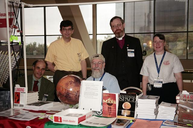 Members of the Mars Society pose at their booth at the International Space Development Conference