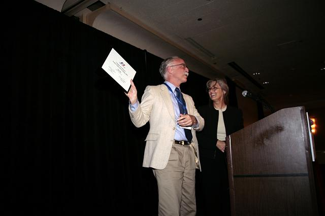 NSS Orange County Space Society chapter member receiving the NSS Chapter Excellence: Public Outreach and Media 2007 Award from NSS Vice President for Chapters Candace Pankanin at the International Space Development Conference