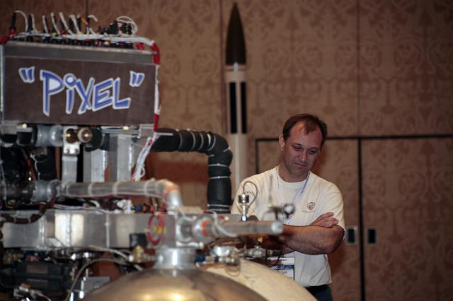 Phil Eaton checks out Pixel: an Armadillo Aerospace vehicle on display at the International Space Development Conference