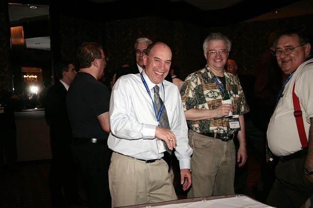 NSS Vice President of Development Robbie Gaines (L) voguing for the camera while Jim Plaxco (center), chair of the NSS Web Oversight Committee, and Tom Koszoru (R), chair of the NSS Chapters Assembly, look  on at the International Space Development Conference