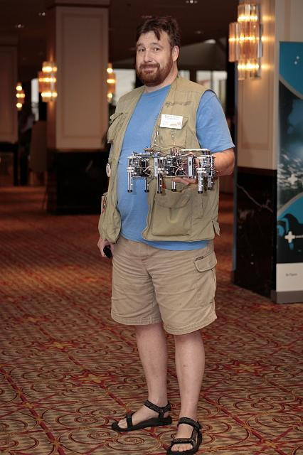 Brian E. Clough poses with a robotic creation at the International Space Development Conference