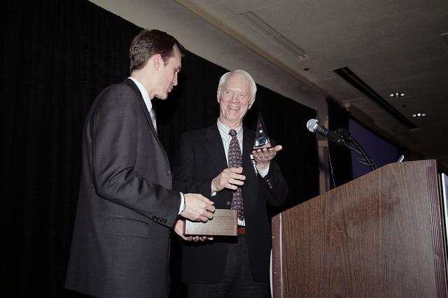 NSS Executive Director George Whitesides gives Rusty Schweickart, Apollo  Astronaut and B612 Foundation Founder, an NSS pyramid as thanks for a speech about Near Earth Asteroid detection, and deflection at the International Space Development Conference