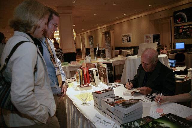 Author Ben Bova signs copies of his many books at the Authors Table at the International Space Development Conference