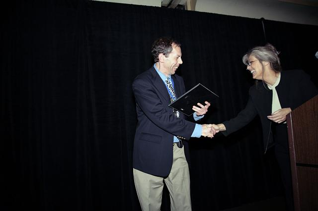 Seth Potter of the NSS OASIS chapter accepting the NSS Chapter Excellence: Chapter of the Year 2007 Award for the OASIS chapter from NSS Vice President for Chapters Candace Pankanin at the International Space Development Conference