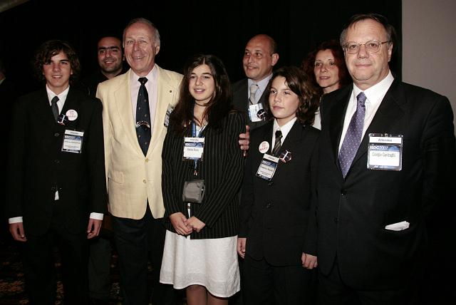 Ben Bova, author and member of the NSS Board of Governors, poses with a group of students at the International Space Development Conference