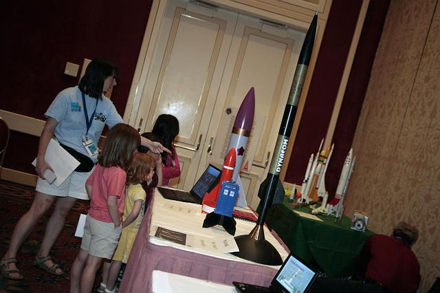 NSS staff give a tour of the space company exhibits to the children of attendees at the International Space Development Conference