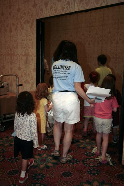 NSS volunteers give a tour of the exhibits to the children of attendees at the International Space Development Conference