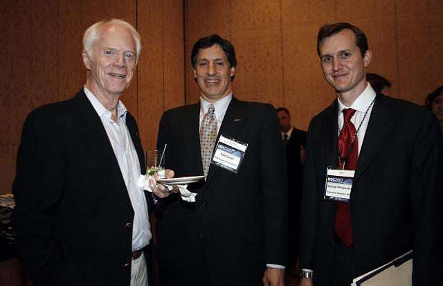 Apollo Astronaut and B612 Foundation founder Rusty Schweickart, Lon Levin, and NSS Executive Director George Whitesides pose at the Space Venture Finance Symposium reception, a part of the International Space Development Conference