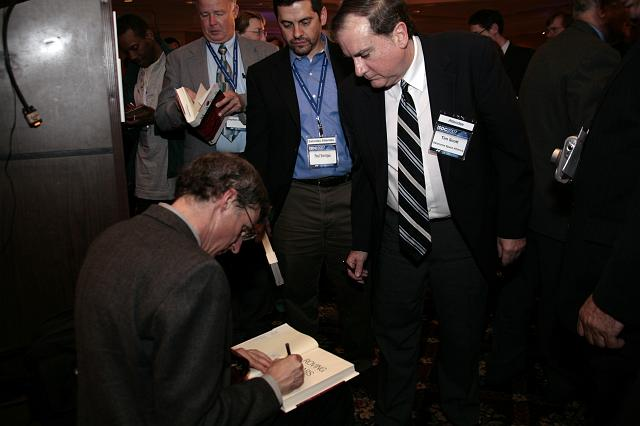 Steven Squyres signs copies of his book Roving Mars at the International Space Development Conference