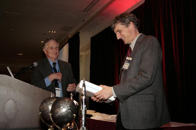 Mars Exploration Rover Principle Investigator Steven Squyres receiving a biography of Wernher von Braun from NSS Governor Frederick I. Ordway III at the International Space Development Conference
