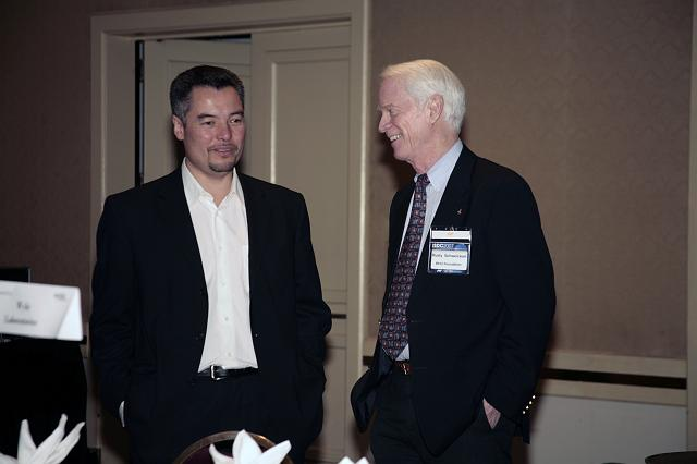Virgin Galactic's Alex Tai talks with Apollo Astronaut and founder of the B612 Foundation Rusty Schweickart during a luncheon at the International Space Development Conference